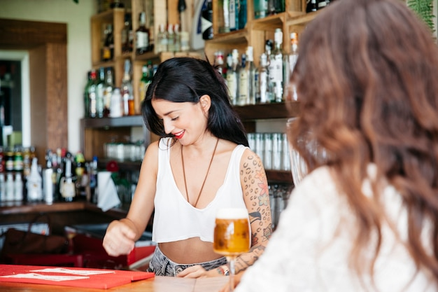 Bartender and woman with beer