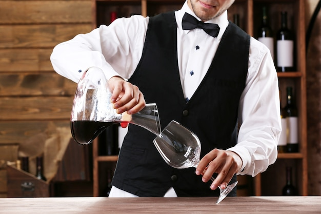 Bartender working at counter on bar surface