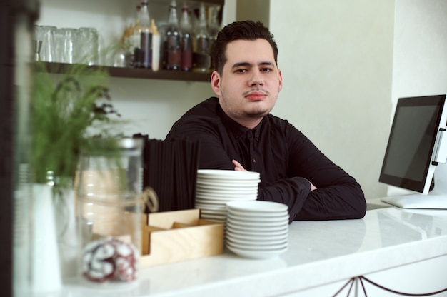 Bartender in a working environment in the cafeteria