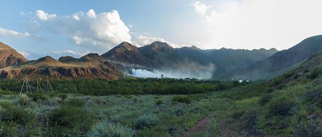 Bartogai dam on a mountain river chilik, kazakhstan upcast of water