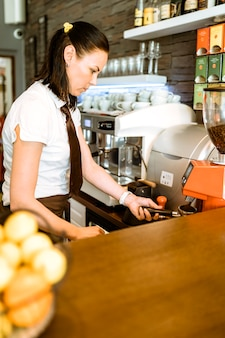 Barwoman making coffee