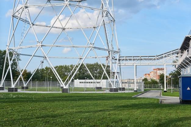 The base of a huge lattice television tower with a technological bridge