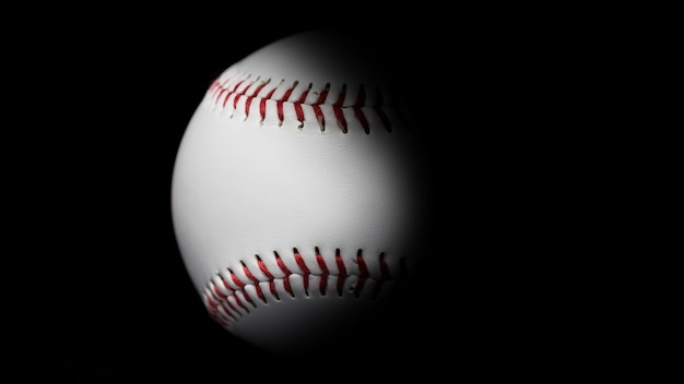 Baseball in black background.