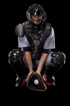 Baseball catcher with his safety helmet