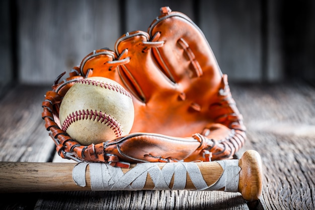 Baseball and glove on a wooden surface