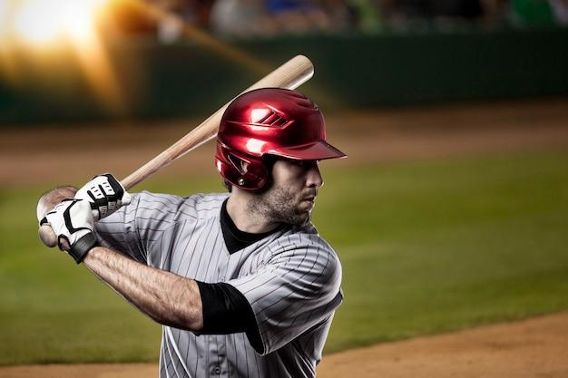 Baseball player on a baseball stadium.