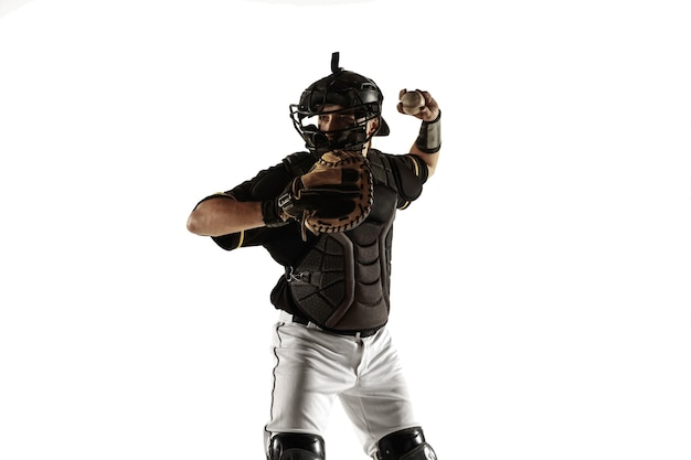 Baseball player in a black uniform practicing and training isolated on a white background