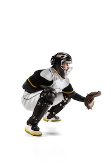 Baseball player catcher in white sports uniform and equipment isolated on a white wall