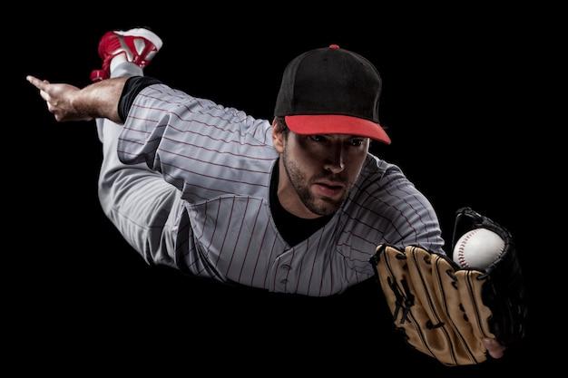 Baseball player catching a ball  . studio shot.