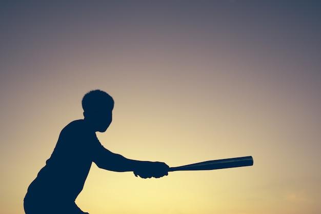 Baseball player on light of sunset