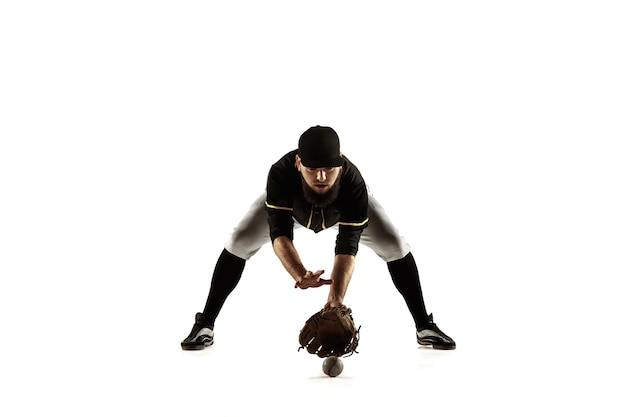 Baseball player, pitcher in a black uniform practicing and training isolated on a white background.