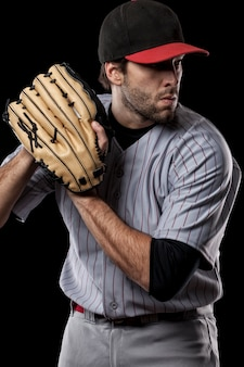 Baseball player pitching a ball  . studio shot.