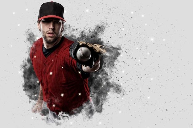 煙の爆発から出てくる赤いユニフォームの野球選手。