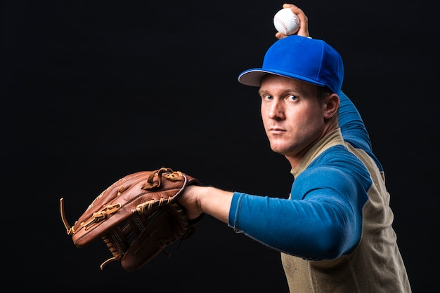 Baseball player with glove throwing ball