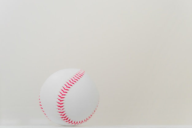 Baseball on table with white background