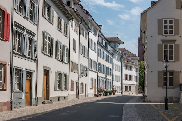 Basel, switzerland - june 19, 2017: walk through old buildings in historic center of basel city. summer day with blue sky