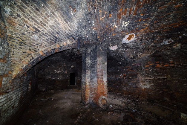 Basement of old house with domed vault and supporting column russia in orenburg