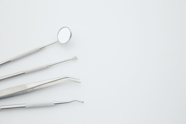 Basic dentist tools on white. dental health and teethcare concept.