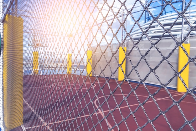 Basket ball court with mesh wire protection
