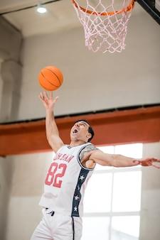 Basket-ball. sportman throwing a ball into the basket