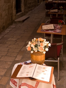 Basket of flowers on a table in dubrovnik