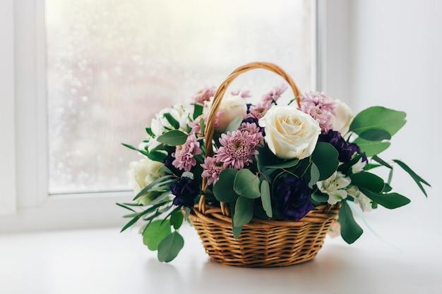 Basket of flowers on the window, vintage colors