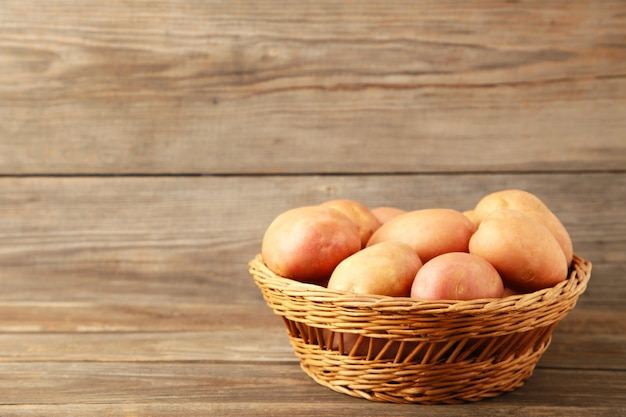 Basket of fresh tasty new potatoes on grey background. top view