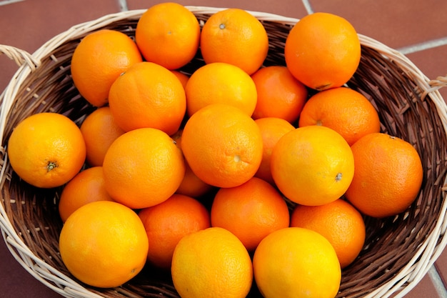 Basket full of oranges with a glowing skin