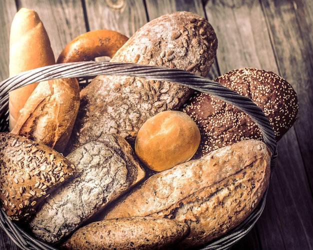 A basket of a variety of fresh bread close up