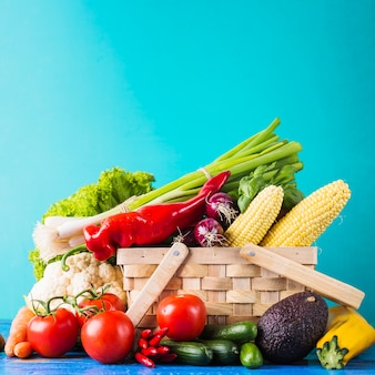 Basket with assortment of raw vegetables
