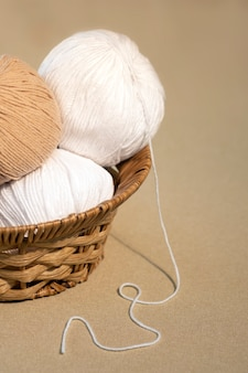 Basket with balls of yarn for knitting. claws, skeins of wool.copy space.