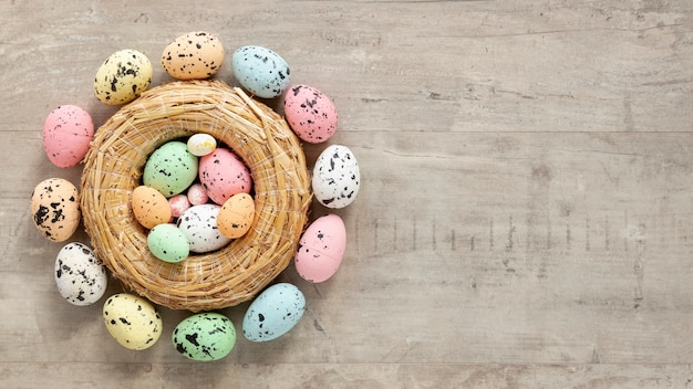 Basket with colorful painted eggs for easter