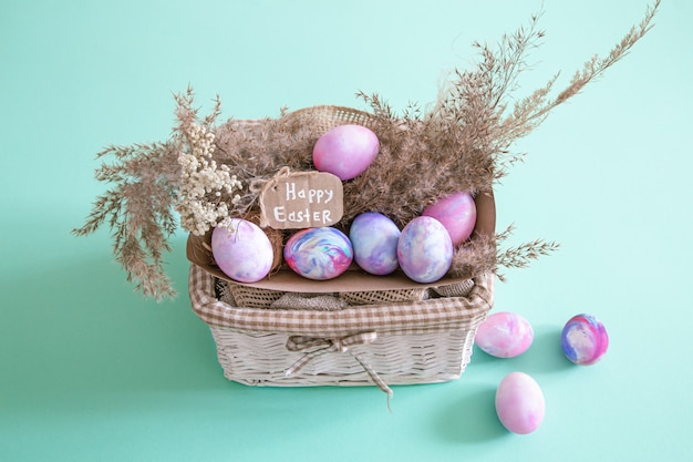 Basket with easter eggs on a colored isolated background.