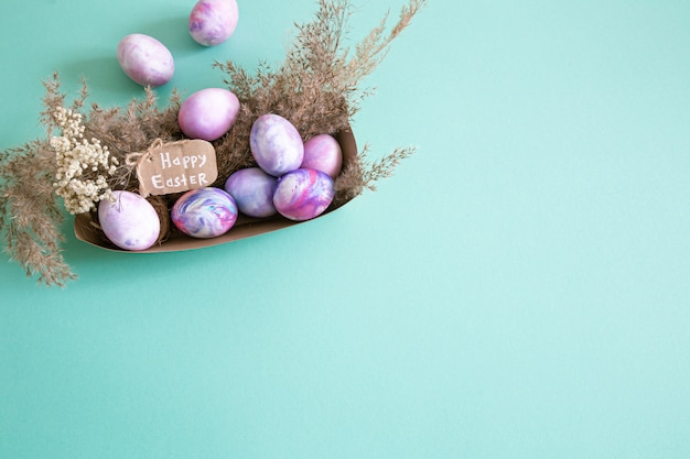 Basket with easter eggs on colored isolated