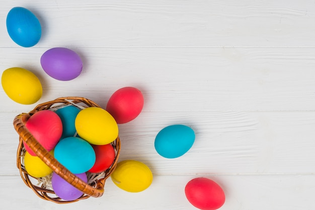 Basket with easter eggs on light table