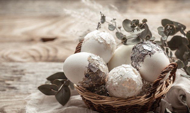 Basket with eggs and dried flowers. an original idea for decorating easter eggs.