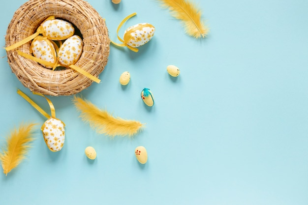 Basket with eggs and feathers beside