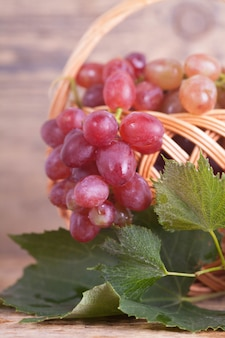 Basket with grapes against