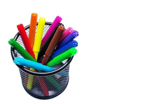 Basket with multi-colored felt-tip pens on a white background