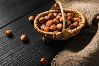 Basket with nuts near cloth
