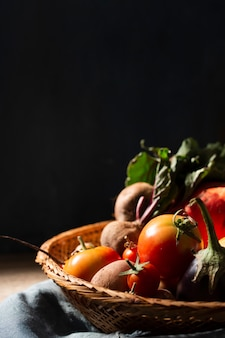 Basket with organic tomatoes and radishes