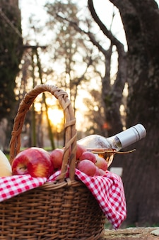 Basket with picnic goodies at dawn