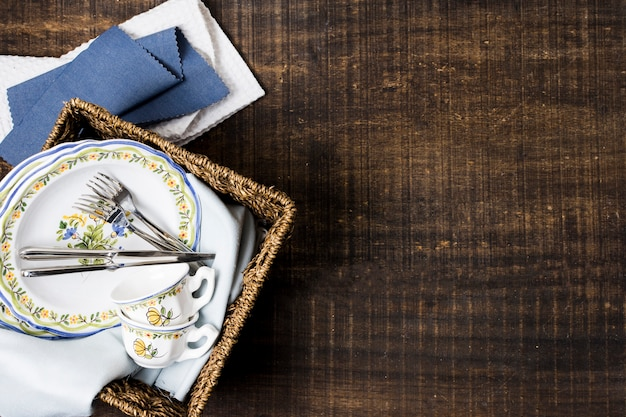 Basket with plates and tableware with copy space