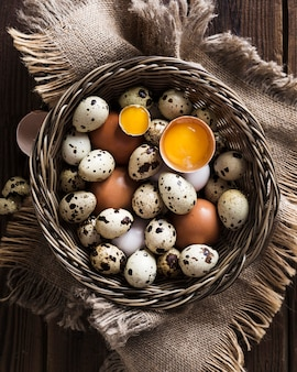 Basket with quail and chicken eggs