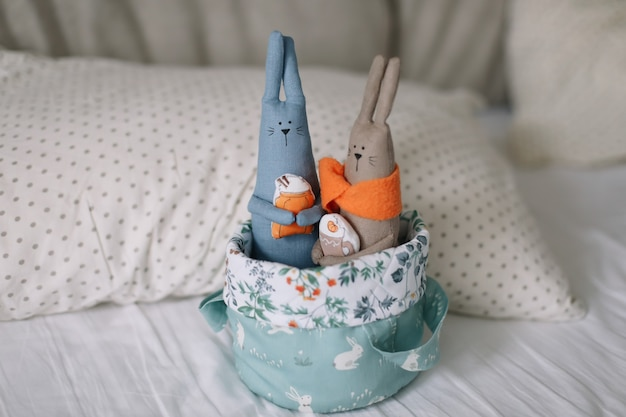 Basket with rabbit toys in a cozy nursery