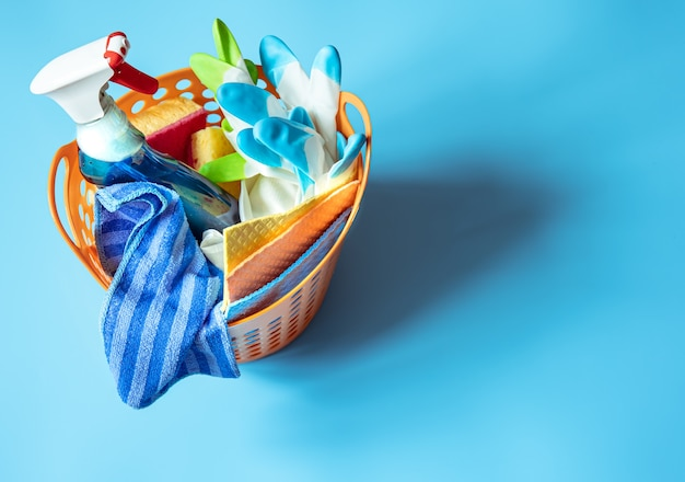 Basket with a set of accessories for cleaning. sponges, rags, detergent and gloves  background