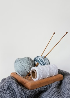Basket with wool and knitting needles