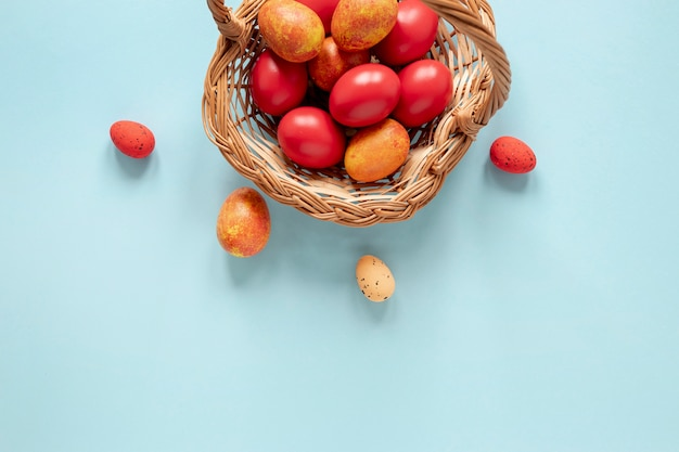 Basket with yellow and red painted eggs