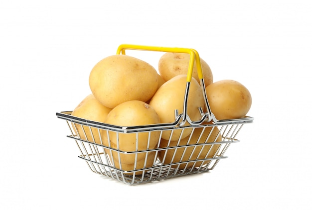 Basket with young potato isolated on white surface