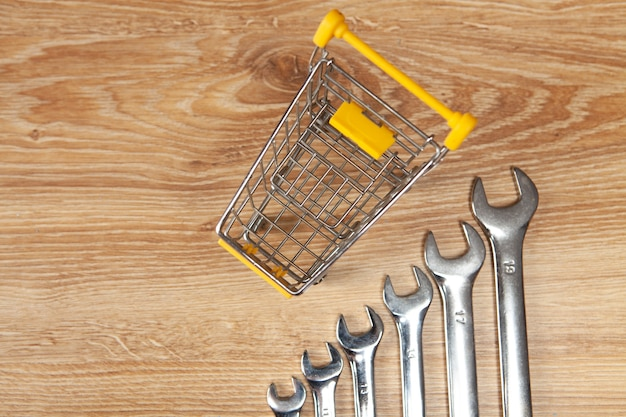 Basket and wrenches. online shopping concept